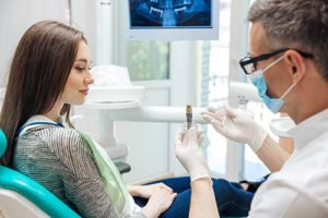 woman in need of dental implants