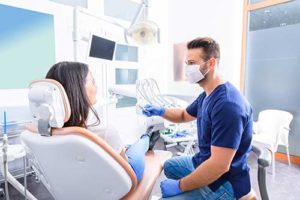 a woman seeks an emergency dentist